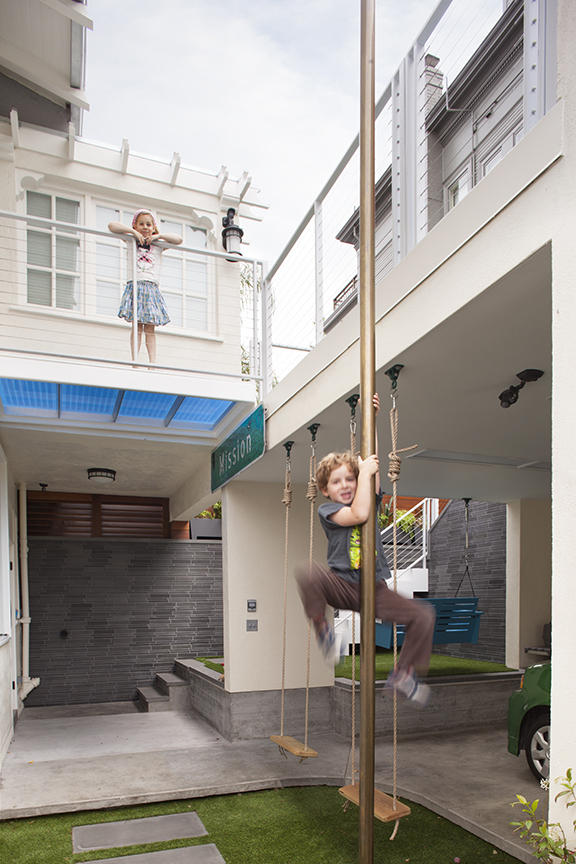 Kids Fire Pole and Swings Carport Design Makes for Creative Outdoor Living Space